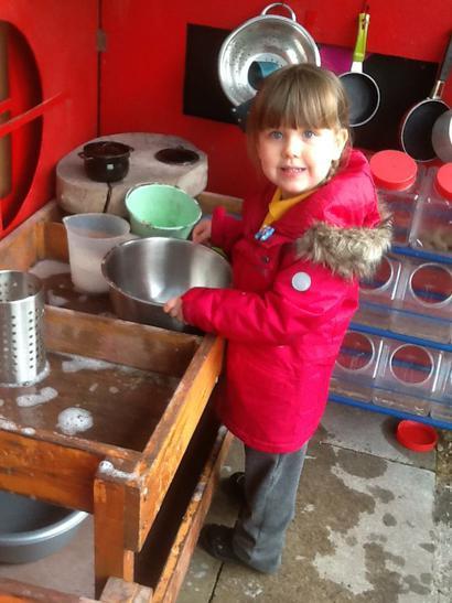 Working in the Mud Kitchen.