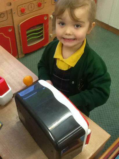 Ella preparing a hotdog for Talia.