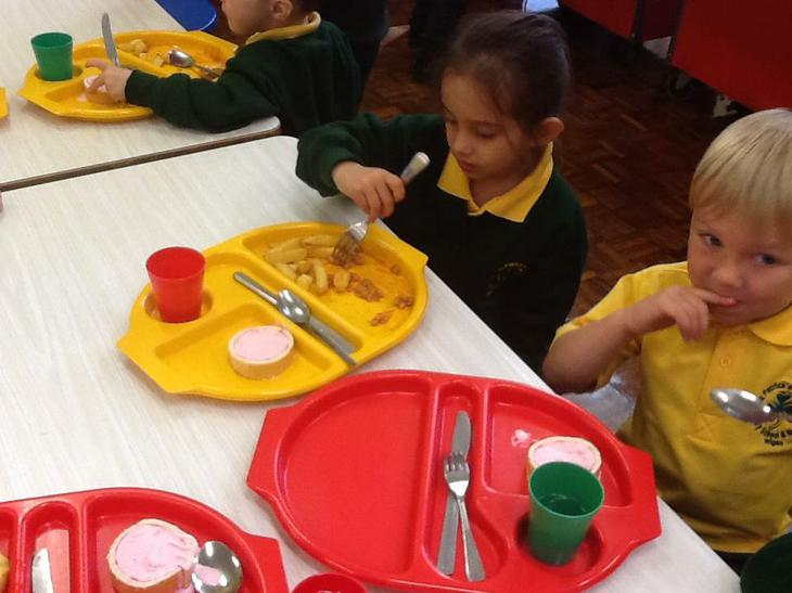 We learned how to use our knives and forks to eat.
