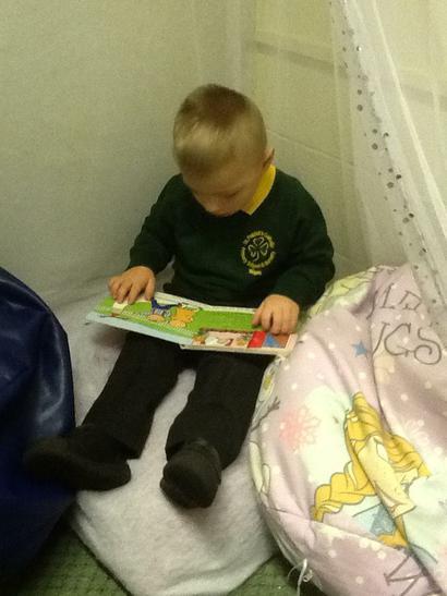 Patrick enjoying a book in the Reading Corner.