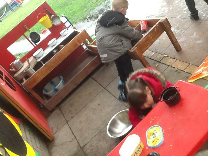 Working in the Mud Kitchen.