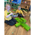 Evie and Harry worked together to make a helicopter using the bau play.
