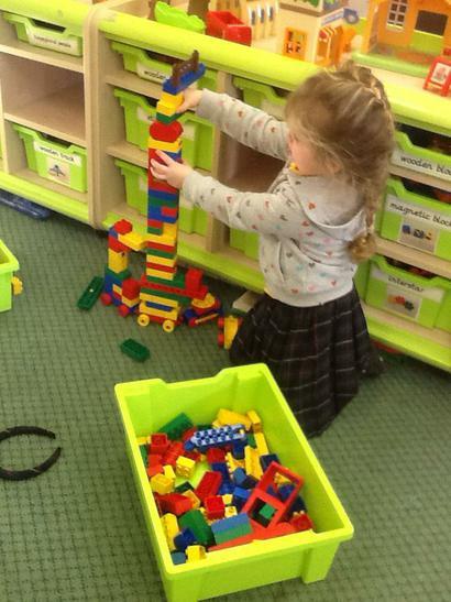 Jessica building a giraffe.