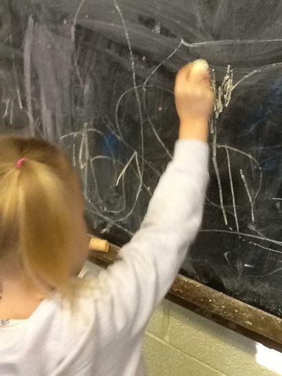 Using chalk to mark make.