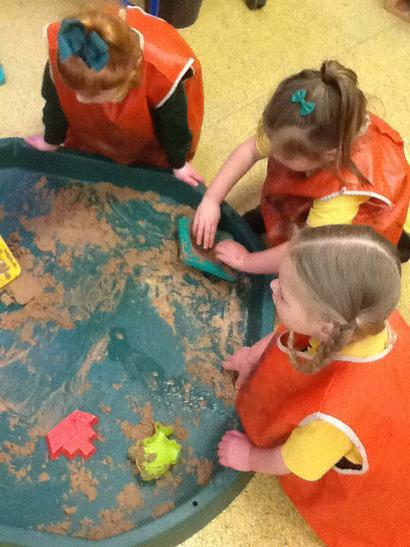 Making animals using sand moulds.