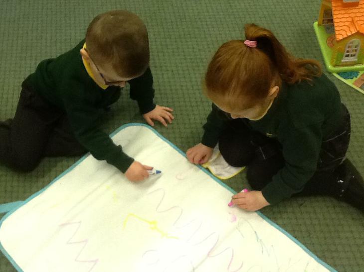 Using our mark making Crayola mat.