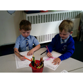 Colouring in and developing our fine motor skills.