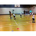 Dribbling skills with hockey sticks.
