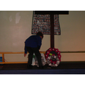 Class wreaths are laid at the foot of the cross