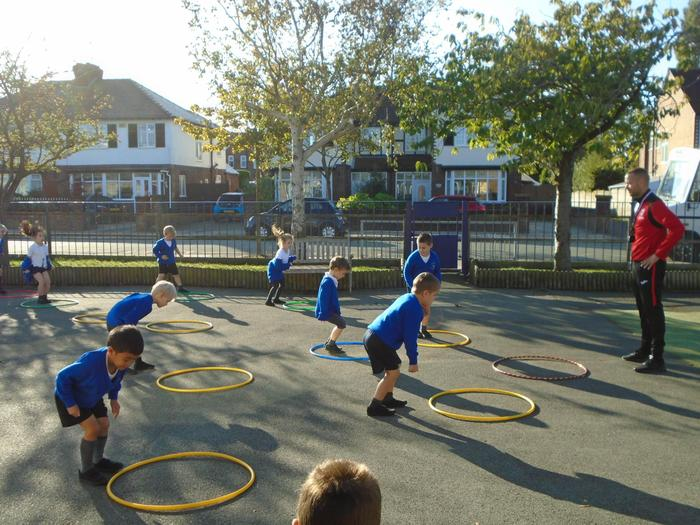 Enjoying P.E in the sunshine.