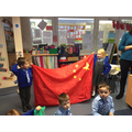 Holding the Chinese flag.