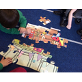 We used great team work when we made a great jigsaw puzzle.