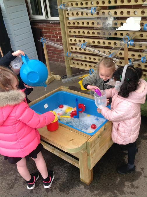 Exploring capacity and control when pouring.