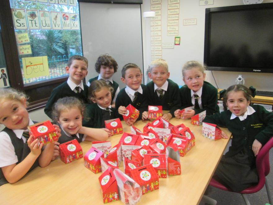 We collected money in our little red money boxes