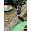 Isla exploring maths outdoors