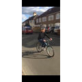 Mrs Roach riding a  bike for the first time!