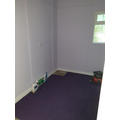 Purple carpet and walls in the sensory room