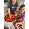 Anna making pizza with David, yum!