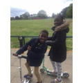 Anayah and Izaiah on their scooters