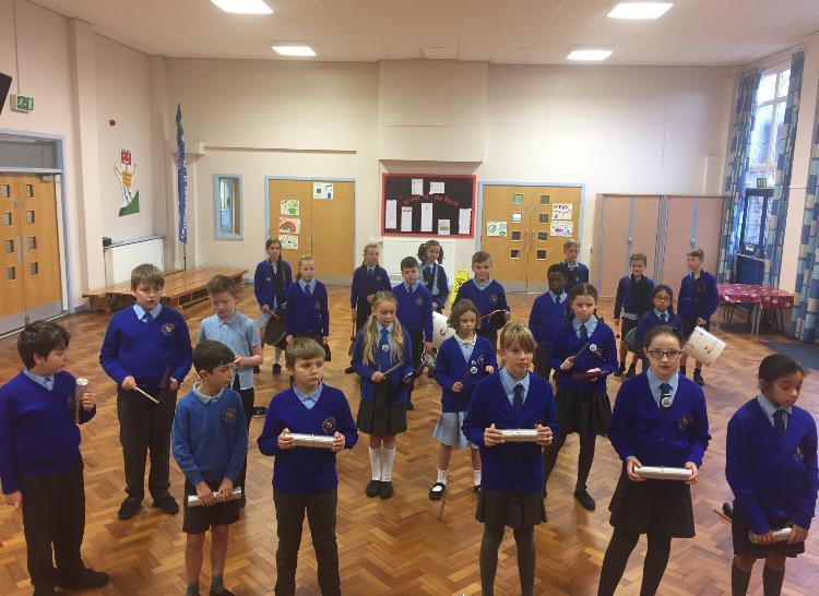 Practising percussion in Music.