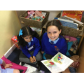 Year 6 reading in Reception on Friday afternoons.