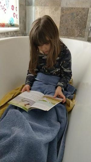 Emma read in the bath!