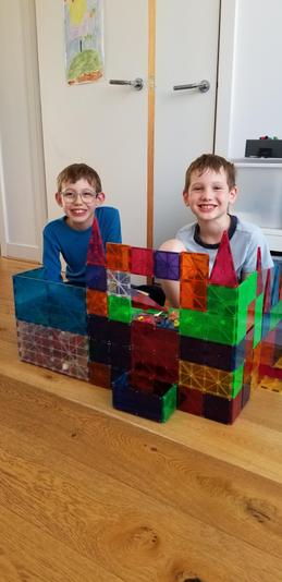 Caleb and Colin - Years 4 and 2 - Practising money in their shop.jpg
