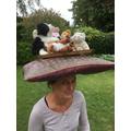 Mrs Mezits has balanced 10 things on her head!