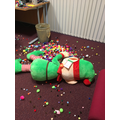 Big Elf playing with art clubs pompoms!