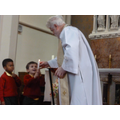Luca held the baptismal candle.