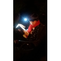 On a park bench with a head torch!