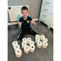 Arranging toilet rolls in the shape of 100