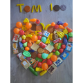 Making a heart with 100 pieces of play food