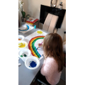 Claudia create a rainbow for her window.