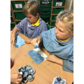Mixing paint, using a range of different sized brushes and sponges.