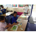 Painting a lily pond in the style of Monet.