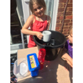 Bella measuring capacity of containers.