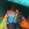 Oliver reading in his den.