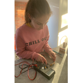 Year 6: Testing batteries using a fluke machine to measure the voltage in each battery.