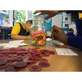 Estimating in maths. How many sweets do you think are in the jar?