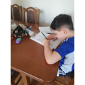 Jakub practising his handwriting.