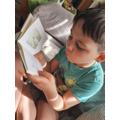 Jakub reading Peter Rabbit.