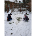 Mr T's children, Noah and Isla, building their igloo!