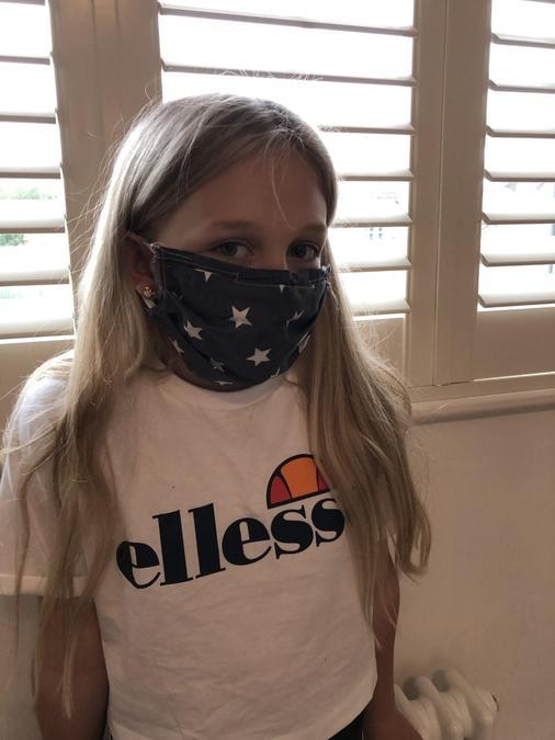 Eva models her mask