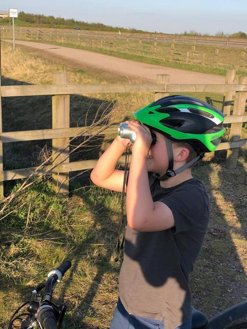 Isaac surveying the scenery whilst cycling