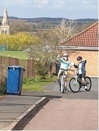 Chloe and Noah cycling up steep hills!