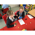 Playing 'Roll the dice' to describe 3D shapes.