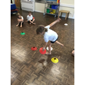 Using balancing skills to complete a task.