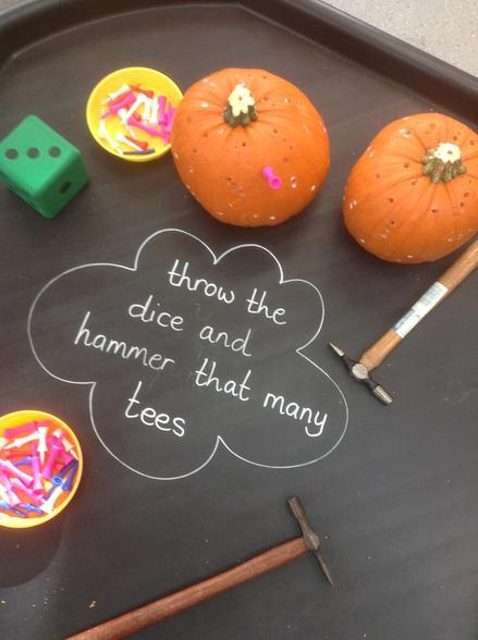 Hammering tees in pumpkins is great fun!