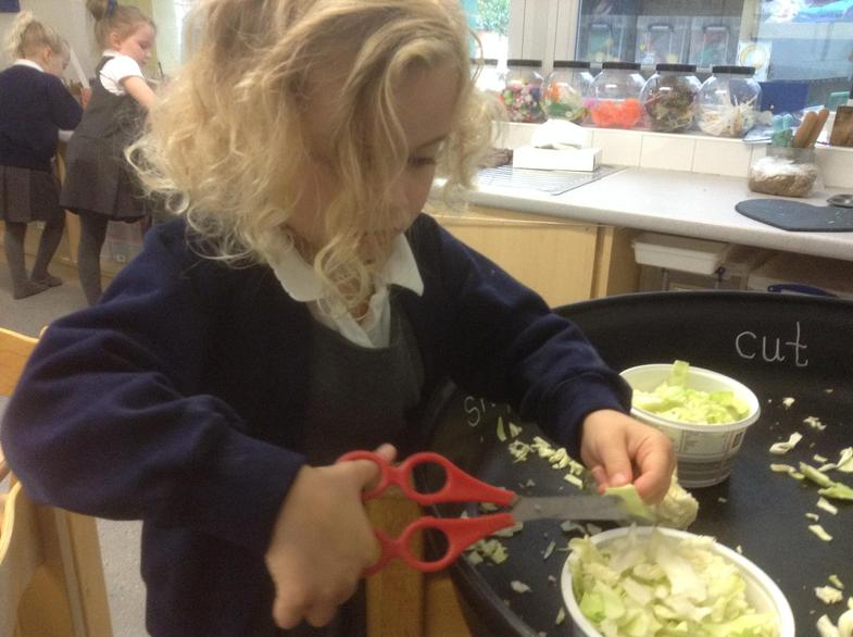 Practising snipping with scissors